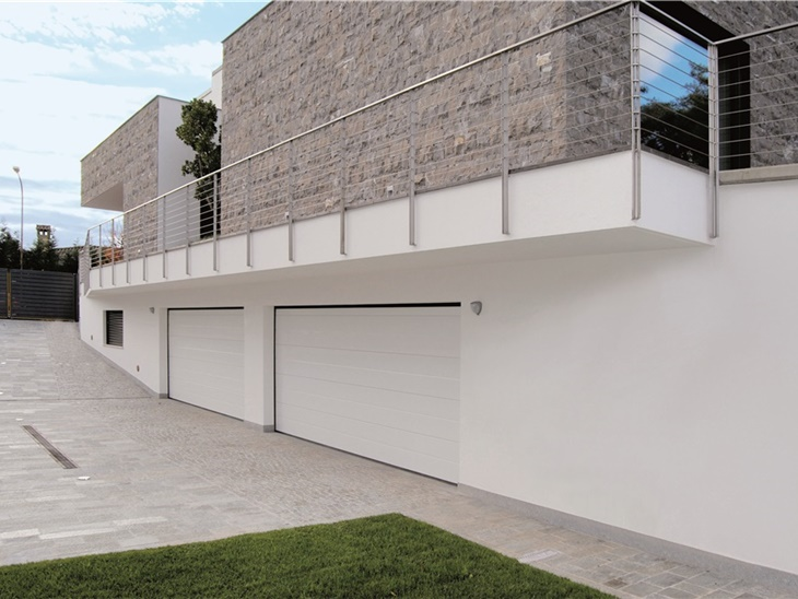 Porte sezionali industriali e residenziali